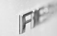 F is for Fiesta (Elisafox22 catching up again ;o)) Tags: elisafox22 sony ilca77m2 100mmf28 macro macrolens telemacro lens monochromebokehthursday monochrome bokeh dof shadows lettering f fiesta silver dust rust corrosion motorcar car blackandwhite monotone reflections bw mono greyscale elisaliddell©2018