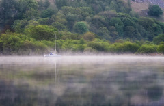 Drifting in the mist (Pete Rowbottom, Wigan, UK) Tags: ullswater boat yacht mist fog reflections water beauty cumbria landscape nature travel trees dawn sunlight sunrise bright surreal peterowbottom nikond750 colourful waterreflections singleboat glenridding tranquil serene peaceful calm drifting waterscape uk britain england nikon70200f4 shoreline simplicity detail depth hills hillside lakedistrict