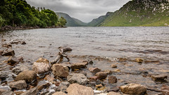 Moody scene from Beragh Lough (jac.photography49) Tags: beach clouds donegal exposure fullframe f4 fauna grass shore ireland images view wideangle rocks 5dmkiii sky lough mountain ngc glenveagh national park river tree valley waves water