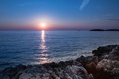 Sunset in Istria, Croatia (Dax Borghi) Tags: sunset twilight sun sky blue water sea adriatic rock rocks tramonto mare adriatico croazia croatia blu reflection riflesso cielo sole acqua vividstriking