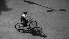 Shadow ride (+Pattycake+) Tags: shadows cyclist wheels monochrome norwich street people cycle blackandwhite moon bw uea rider transport