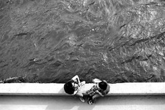 At the river edge (pascalcolin1) Tags: paris seine rivière river bord edge quais eau water femme women photoderue streetview urbanarte noiretblanc blackandwhite photopascalcolin 50mm canon50mm canon