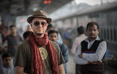 Jampal (andy_8357) Tags: portrait portraiture new delhi india tibetan train platform kind friendly onlookers hat natural light sunglasses sony a6000 alpha 6000 ilcenex ilce6000 nikkor 105mm f25 ai scarf man young people moustache goatee beard