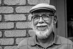 Street Portrait Project.... (Kevin Povenz Thanks for all the views and comments) Tags: 2018 june kevinpovenz westmichigan michigan holland hollandstreetperformers street streetphotography streetportrait portrait man male canon7dmarkii sigma24105art beard hat glasses wall blackandwhite bw smile