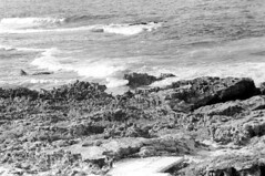 073670 06 (ndpa / s. lundeen, archivist) Tags: nick dewolf nickdewolf july blackwhite photographbynickdewolf bw 1970 1970s monochrome blackandwhite film mexico mexican yucatán yucatan yucatanpeninsula caribbean islamujeres island water ocean sea coast watersedge waves surf rocks rocky