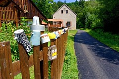 Fence with mugs (Yirka51) Tags: gate turistmark pale cup wooden wood window village summercottage screw roof pathway path ornament house handrail guardrail grass garden forest fence exposition exhibition decorated countryside country cooking bush building architecture