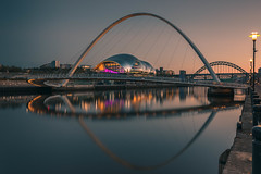 Reciprocal (raymond_carruthers) Tags: wilkinsoneyre england bridge rivertyne newcastle reflections city gateshead longexposure sagegateshead sunset sunsetcolours evening river cityscape bridges quayside architecture arc tynewear tynebridge arch gatesheadmillenniumbridge