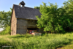 Parked_187570 (rjmonner) Tags: barn truck cupola iowa farm farming agriculture agricultural parked corncrib relic rural country rustic farmstead farmyard summer summertime architecture isolated shed cornbelt