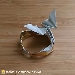 "Origami  Challenge 55/365 ""Uroboro"" Modello creato nel 2015. ------------------------------------------- ""Ouroborus"" Model created in 2015.  #origami #cartapiegata #paperfolding #papiroflexia  #paper #paperart #createdandfolded #originaldesign   #danielac (Nocciola_) Tags: ouroboros uroboro paperart cartapiegata createdandfolded papiroflexia paperfolding ouroborus originaldesign danielacarboniorigami paper origami"