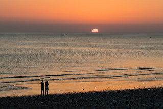 Sunset at the beach with romantic couple