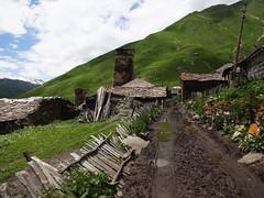 dirt road (annabunin) Tags: georgia svanetia ushguli village fence fencedfriday mud road caucasus mountains