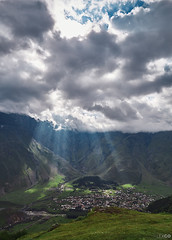 Kazbegi and Godrays (kle1n) Tags: landscape mountainside sky grass mountain
