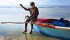 Yuh Haffi Guh Weh Di Fish (Poocher7) Tags: people portrait man rastamon dreadlocks beard sunglasses sitting fishingboat boat shore water ocean caribbeansea fishingpoles reflections sunny jamaica westindies caribbean mobay montegobay fisherman