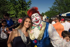 Katie's Clown (BarryFackler) Tags: tasteofomaha heartlandofamericapark fair festival event outdoor katiefellbaum katielynnfellbaum happydclown clown entertainer performer makeup wig bowtie vest smiling family smiles smile 2018 sunny trees sky vacation tasteofomaha2018 barryfackler barronfackler