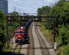 Under the signal bridge (Michael Berry Railfan) Tags: cp8006 cp9526 cp canadianpacific ac44cwm ge generalelectric cp650 train ethanoltrain montreal adirondacksub
