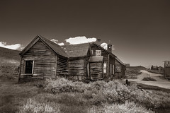 House Behind the Church (CameraOne) Tags: church ruins sepia houe abandoned urbandecay owensvalley statepark bodie ghosttown raw cameraone wideangle monochrome blackandwhite canon6d canonef1740mm polarizer historic wood excapture ih