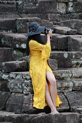 leggy photographer (KENO Photography) Tags: photographer legs yellowdress adult angkor ruins rocks bayontemple beautifulwoman beauty longhair cambodianappearance cloudsky colourimageday frontview vertical looking camera oneperson onewomanonly oneyoungwomanonly woman outdoors people photography portrait sculpture siemreap stone object tourism travel youngadult templecomplex sky destinations vacation