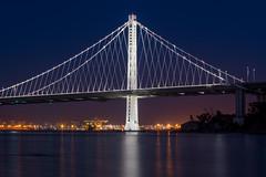 Out do yourself (KurteeQue) Tags: california night bridge bluehour reflection baybridge oakland water waterreflection nikon teamnikon treasureisland bayarea sanfrancisco