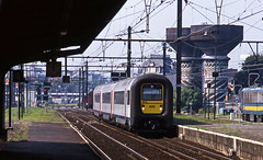 SNCB IC unit 480 forming a terminating service from Gent arriving at Antwerpen Oost 24August01 (mikul44171) Tags: 480 sncb480 ic antwerpnoost watertowers clock