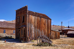 Abandoned Building and Cart at Bodie Ghost Town in HDR (eoscatchlight) Tags: bodieghosttown easterncalifornia ghosttown abandoned hdr photomatix