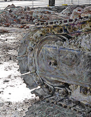 Smashing Concrete is as Easy as Smashing Pumpkins (Steve Taylor (Photography)) Tags: demolition digger excavator caterpillar tracks mud earth heavy construction machinery puddle digitalart fence closeup concrete metal rubble water newzealand nz southisland canterbury christchurch cbd city texture winter