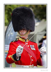 The Conductor (Seven_Wishes) Tags: newcastleupontyne newcastlemilitaryshow2018 jo outdoor photoborder canoneos1dmarkiv canonef70200mmf28lisii people candid conductor music uniform military band bearskin portrait meninuniform red hat medals dof depthoffield edoliverphotography 2018 tyneandwear uk