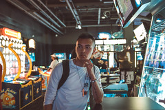 In thought (Jay Salazar) Tags: photography tutorials asians portraits arcade daveandbusters
