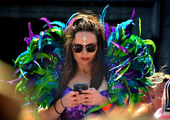 Parade Queen (Owen J Fitzpatrick) Tags: ojf people photography nikon fitzpatrick owen pretty pavement chasing d3100 ireland editorial use only ojfitzpatrick eire dublin republic city tamron candid joe candidphotography candidphoto unposed natural attractive beauty beautiful woman female lady j face hair along white photoshoot street 2018 streetphoto pride st saint stephens green south parade assembly area colour colourful device phone shades digital sunglasses brunette lipstick hold handset reflective queen