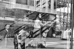 Going Up 1 (FunkyPepper) Tags: vancouver escalator goingup streetphotography streetwise candidstreetphotography reflection people woman candidshot photographer canada nikon d810 blackandwhite bw