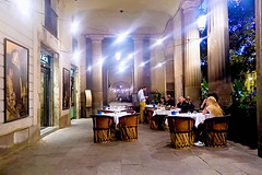 In time for supper (Fnikos) Tags: street people cena cenar sopar supper restaurant table seat light art painting column architecture wall classical plant nature night outdoor
