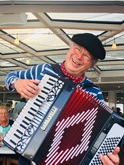 Happy musician Paris, France on board river cruise (ArtsySF©Marjie) Tags: river viking accordion happy smiling 619181150amparistime france paris vikingrivercruise cruise musician