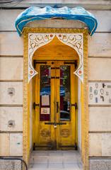 Bul-india (TablinumCarlson) Tags: restaurant india indien sofia bulgaria europa europe bulgarien tür door entry graffiti facade fassade sumicron leica m m240 28mm gelb yellow eingang portal