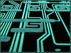 Glowing Edges - MM - Theme-Inside Electronics (LOVE.OVER.LUST.) Tags: mm macromondays insideelectronics tvremote touchpad nightglow aqua turquoise black circuitboard sundaylights