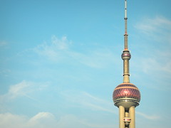 Top of iconic Shanghai Oriental Pearl Tower against blue sky - China (Germán Vogel) Tags: asia eastasia china travel traveldestinations traveltourism tourism touristattraction landmark holidaydestination famousplace shanghai architecture modernarchitecture contemporaryarchitecture bluesky blue pudong financialdistrict growth economy progress development urbanlandscape urbanskyline building orientalpearltower iconic symbol needle top height high up tower telecommunications telecomtower antenna