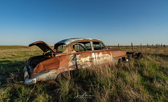 Bullet-ridden Car (Wits End Photography) Tags: view natural landscape decay kansas nature rust rural vehicle picturesque monumentrocks abandoned scenic grassland objects country car corroded corrosion decayed discarded forgotten forsaken metal neglected old outdoor outside oxidation oxidized patina rejected rusty