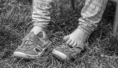 After a hard day of play. (katebosworth1) Tags: feet monochromatic shoes child grass children toes sony