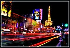Frenzy (VegasBnR) Tags: nikon nevada night neon sigma strip sign street lighttrails lasvegas lasvegasblvd lvbv lights paris ballys vegasbnr vegas vacation geo geografics gimp city colorful