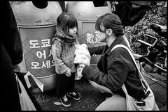 Jingūmae, Shibuya-ku, Tōkyō-to (GioMagPhotographer) Tags: tōkyōto peoplegroup kid jingumae eastofthesun shibuyaku streetscene japanproject japan leicamonochrom tokyo tkyto