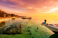 Sunset at Rajuni Island (syukaery) Tags: green sunset rajuni island takabonerate nationalpark humaninterest dailylife pier indonesia nikon nikkor 1635mm d750 activities dusk boats