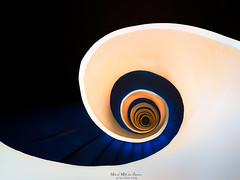 Escalera Hotel Domine, Bilbao (Mimadeo) Tags: staircase spiral step ladder circular climb stairway stair round rotate shape handrail circle curve down up design architecture screw railing perspective twist abstract urban coil snail oval dark highangleview directlybelow color