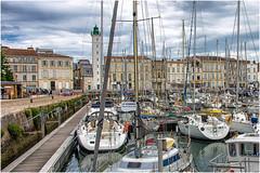 La Rochelle ... ( 3) (miriam ulivi - OFF /ON) Tags: miriamulivi nikond7200 france nouvelleaquitaine charentemaritime larochelle porto barcheavela faro port sailboats lighthouse buildings edifici cielo sky nuvole clouds