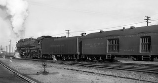 Southern Pacific Baldwin GS-1 oil burning 4-8-4 steam locomotive # 4401, and its soon departing passenger train is seen on station tracks, ca early 1940's