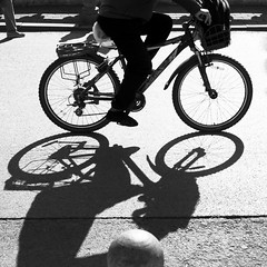 Bicycle and shadow (BryonLippincott) Tags: green nanluoguxiang china asia asian beijing blackandwhite black white bw chinese houhailake park peaceful serene quiet garden buildings tourism bicycle cyclist pedaling riding shadows lake busy street road destination backlight square