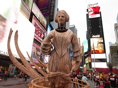 Ship Figurehead Lady Sculpture Times Square NYC 5576 (Brechtbug) Tags: wake unmoored sculptures by artist mel chin climate change themed art times squre midtown manhattan 2018 nyc july 07172018 figurehead lady ship statue boat construction ribs sunken shipwreck artwork wood woodlike carved carving historic past history