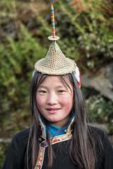 Layap girl in traditional dress - Laya - Gasa District - Snowman Trek - Bhutan (PascalBo) Tags: nikon d500 asie asia southasia asiedusud drukyul drukgyalkhap bhutan bhoutan འབྲུག་ཡུལ། འབྲུག་རྒྱལ་ཁབ་ snowman trek trekking hike hiking lunana gasa himalaya himalayas jigmedorjinationalpark laya layap indigenous people girl fille child enfant kid hat smile sourire chapeau portrait outdoor outdoors pascalboegli 123faves