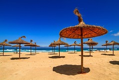 Umbrellas (dietmargötte) Tags: mediterrane sunshine beautifulplaces naturephotography spanien nature islasbaleares travelphotography sea umbrellas beach bluesky spain majorca mallorca calamesquida