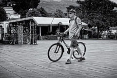 Bike In Head (Alfred Grupstra) Tags: bicycle cycling men people outdoors blackandwhite urbanscene citylife transportation street lifestyles city modeoftransport oneperson cycle males adult commuter summer leisureactivity ohrid macedonia