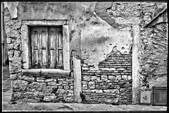Home to Home ? (nicospecial) Tags: ifttt 500px wall crumbling old door weathered red brick masonry boarded up plaster stone doorway nicospecial home blackandwhite