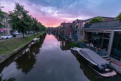 Relaxing at sundown (Dannis van der Heiden) Tags: man dog boat canal water house car flag sky dawn bluehour amersfoort vathorst netherlands nikond750 d750 tokina1628mmf28 quay tree people