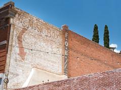 The Music Box (Maureen Medina) Tags: maureenmedina artizenimages bisbee az arizona brick building ghost sign painted musicbox
